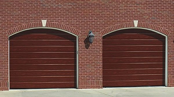 Sectional garage doors carlisle dumfries world group white sectional garage door arched head sectional doors solutioingenieria Images